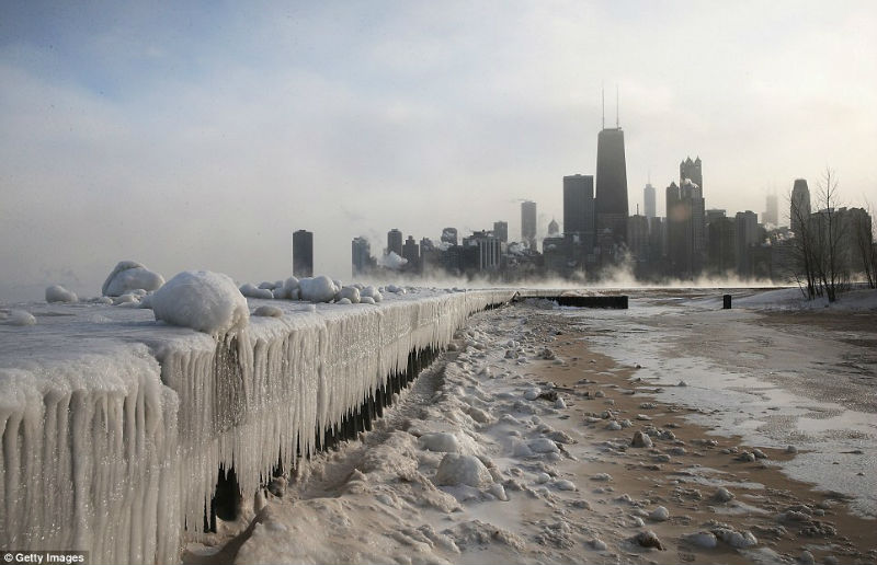 Ice builds up along Lake Michigan at North Avenue BeachRead
